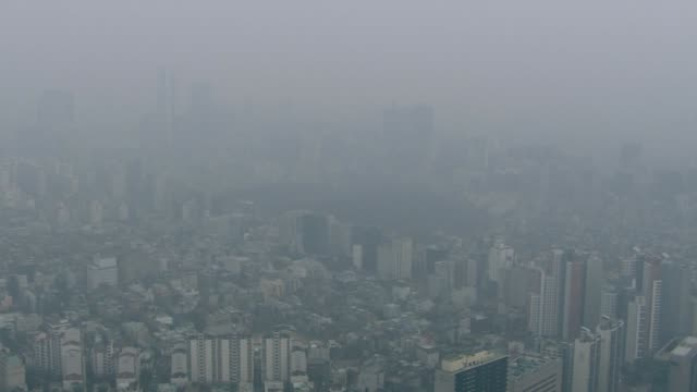 view of fine dust and cityscape in seoul, south korea - luftverschmutzung stock-videos und b-roll-filmmaterial