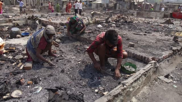 view of fire gutted shanties at the ilias mollah slum in dhaka, bangladesh on march 14, 2018. the fire began on last monday on march 12, 2018. at... - climate stock videos & royalty-free footage