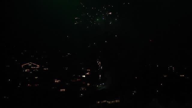 view of firework display in interlaken, switzerland - firework display stock-videos und b-roll-filmmaterial
