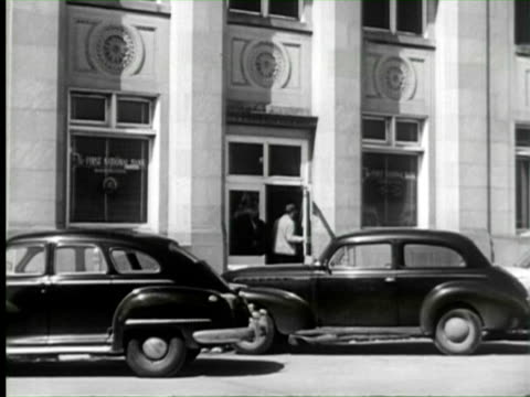 b/w td view of first national bank and people working in bank, united states / audio - banking stock videos & royalty-free footage