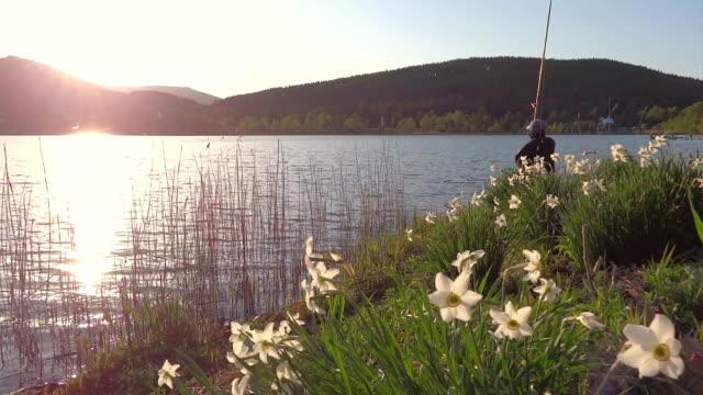 WS PAN View of Fisherman at Shirakaba lake, lake of Betula pendula / Chino, Nagano Prefecture, Japan