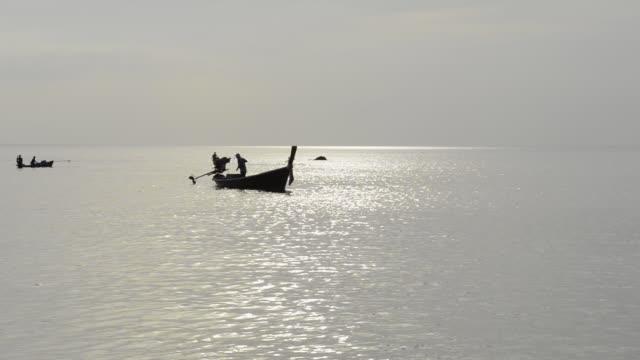WS View of Fisherman in fishing boat at Phra Ae Beach / Island Ko Lanta, Krabi Province, Thailand