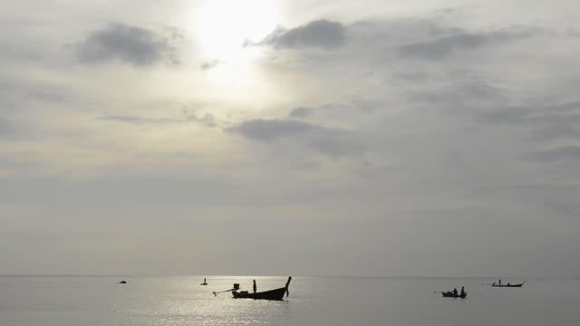 WS View of Fishermen in fishing boat at Phra Ae Beach / Island Ko Lanta, Krabi Province, Thailand