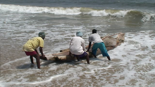 ms ts view of fishermen leaving to sea shore / kerala, india - fisherman stock videos and b-roll footage