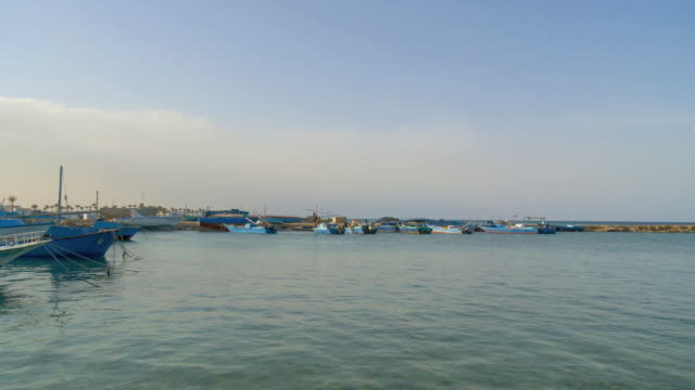 ws pan view of fishing boat at red sea bay / hurghada, red sea coast, egypt - hurghada stock-videos und b-roll-filmmaterial