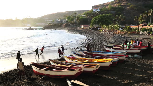 ws view of fishing boats on beach / santiago, cape verde - cidade velha stock videos & royalty-free footage