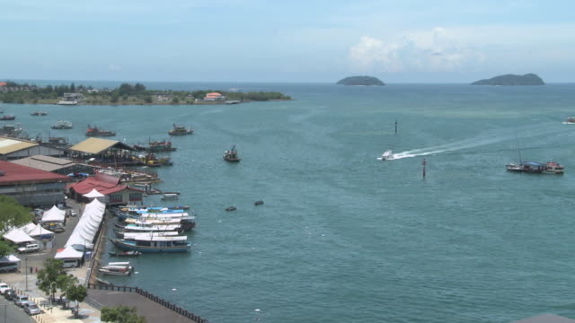 WS T/L View of Fishing port boats coming in and out / Kota Kinabalu, Sabah, Malaysia