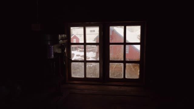view of fishing village on lofoten islands in winter through window - northern europe stock videos & royalty-free footage