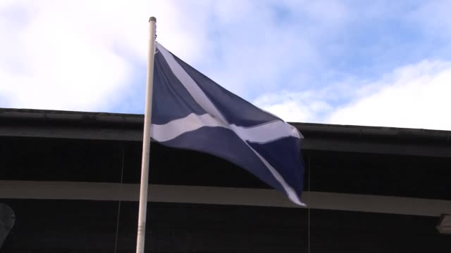 view of flag of st andrew on his masjestys frigate unicorn, berthed in dundee city quay. launched in 1824, she is now the largest intact warship from... - lorraine kelly stock videos & royalty-free footage