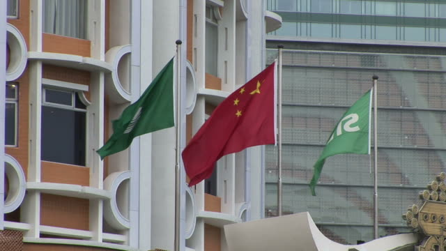 view of flags flapping in macau china - macao flag stock videos and b-roll footage