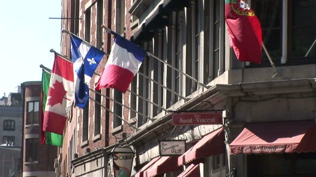 view of flags flapping in montreal canada - ケベックの旗点の映像素材/bロール