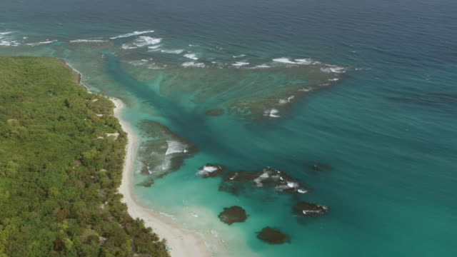 WS AERIAL POV View of Flamenco Beach with coral reefs under clear water / Culebra, Puerto Rico, United States