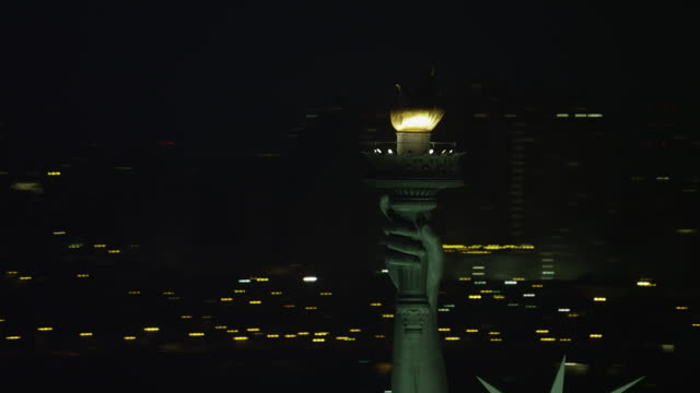 ws aerial view of flaming torch of statue of liberty - flaming torch stock videos & royalty-free footage