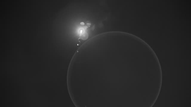 WS TS View of Flare shot into night sky, burning and falling towards earth