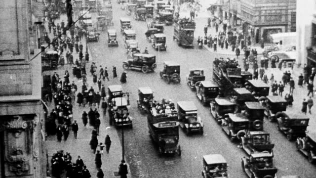 view of flatiron building / tourists on rooftop looking at city view / pedestrians cars and buses on fifth avenue in new york city - 1916 stock videos & royalty-free footage