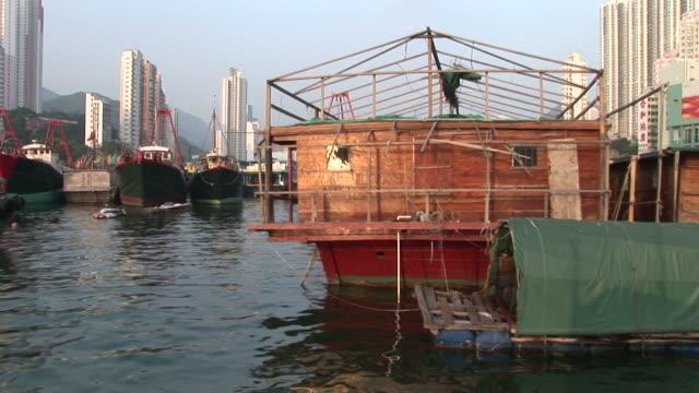 stockvideo's en b-roll-footage met view of floating houses in hong kong china - voor anker gaan