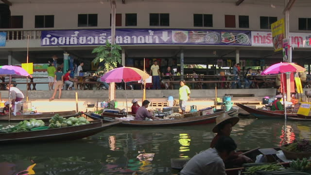WS View of floating market of Damnoen Saduak, market sellers with fruit and vegetable on boats / Bangkok, Thailand