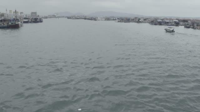 stockvideo's en b-roll-footage met view of floating village, hainan island, china - voor anker gaan