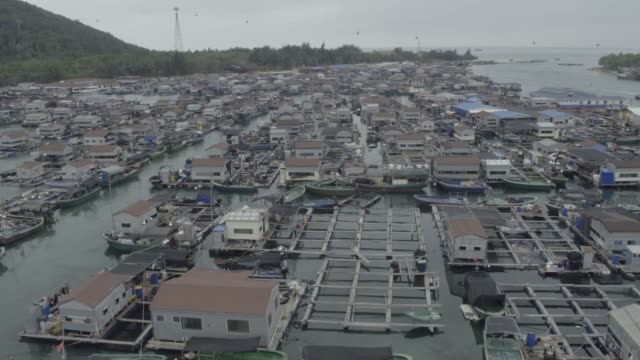 view of floating village, hainan island, china - floating on water stock videos & royalty-free footage