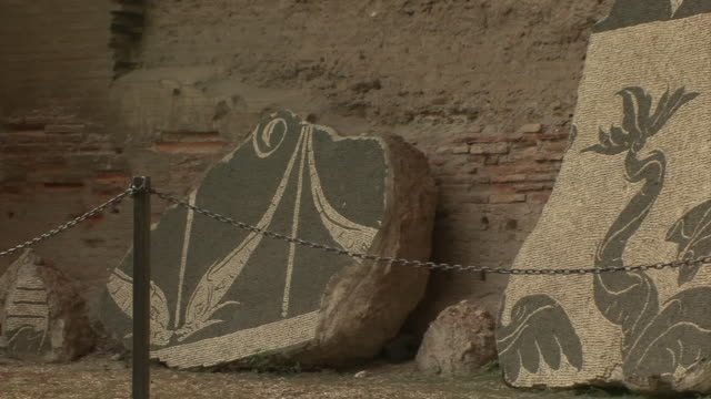 ms pan view of floor fragments of large mosaics in baths of caracalla / rome, italy - mosaic stock videos & royalty-free footage