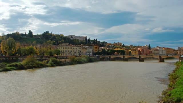 view of florance cityscape over arno river - panoramica video stock e b–roll