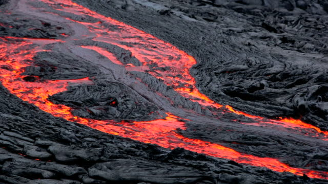 ms t/l view of flowing molten lava river / kalapana, hawaii, usa - lava video stock e b–roll