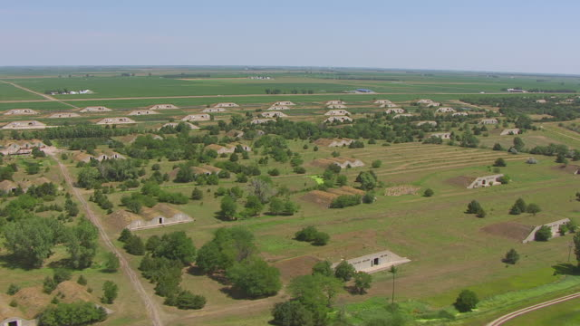 ws aerial view of fly over bunkers at naval ammunition depot / hastings, nebraska, united states - bomb shelter stock videos & royalty-free footage