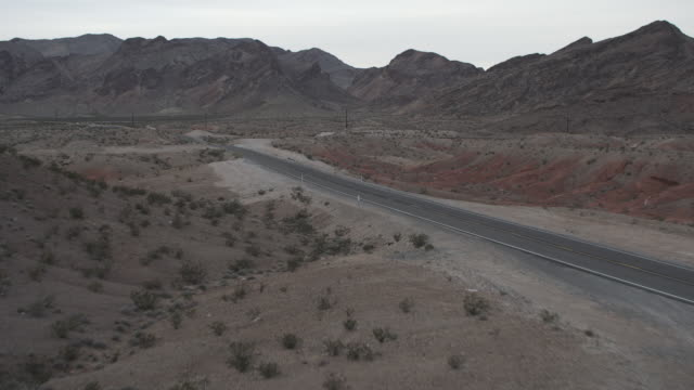 WS AERIAL View of Fly over Desert Highway Road / Las Vegas, Nevada, United States