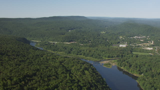 WS AERIAL View of flying over Delaware river with Delaware Water Gap Toll bridge / New Jersey, United States
