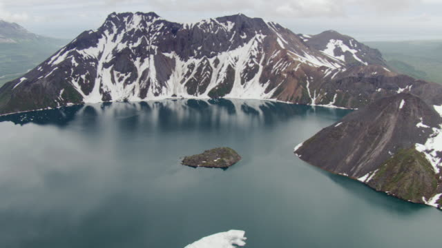 ws aerial view of flying over lake in kaguyak crater in katmai national park / alaska, united states - prehistoric era stock videos & royalty-free footage
