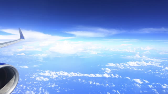 ws aerial view of flying over pacific ocean and clouds / guam - guam stock videos and b-roll footage