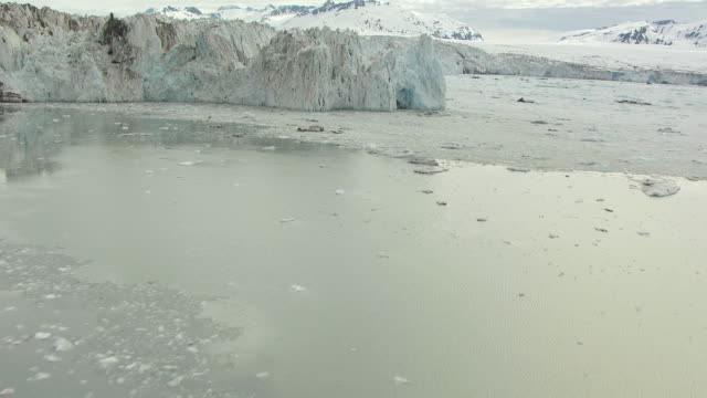 ws aerial tu view of flyover icebergs in water at foot of columbia glacier / alaska, united states - columbia glacier stock videos & royalty-free footage
