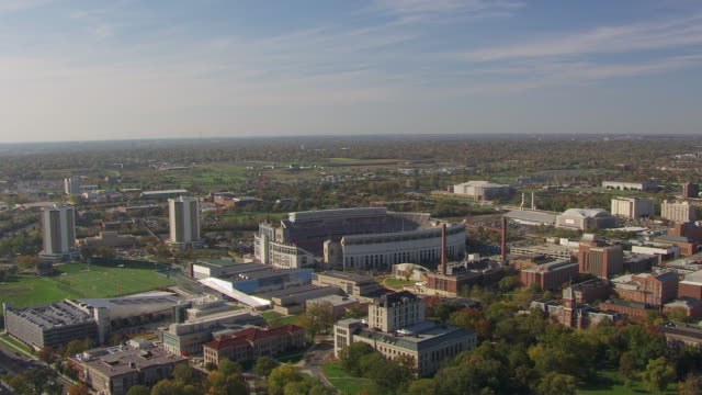 ws aerial view of flyover ohio state university campus with ohio state football stadium / columbus, ohio, united states - ohio state university stock videos & royalty-free footage