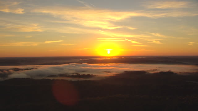 ws aerial view of fog over forest and sunrise / cleveland, ohio, united states - cleveland stock videos and b-roll footage