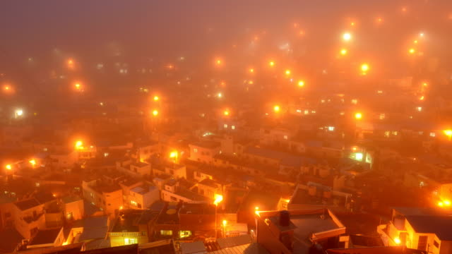View of foggy Gamcheon Culture Villiage at sunset (Famous tourist attractions)