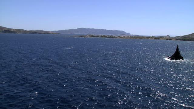 ws aerial view of folegandros island bay between milos and kimolos / folegandros, cyclades islands, greece - greece stock videos & royalty-free footage