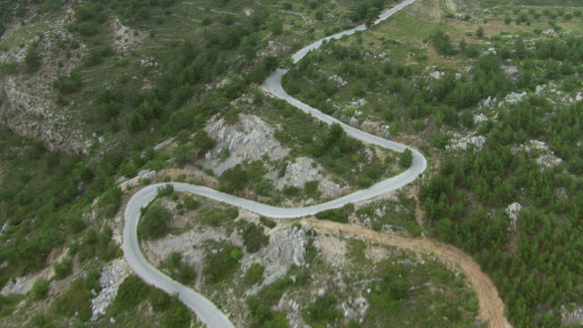 WS AERIAL TS View of following winding long street / Karpathos, Dodecanese, Greece
