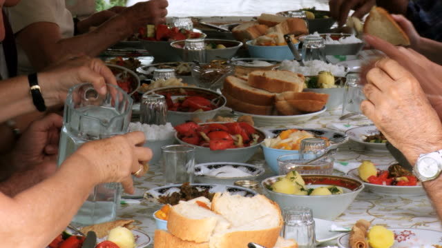 ms view of food on dining table / georgia - eastern european culture stock videos & royalty-free footage