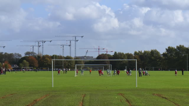 WS View of Footballers playing on Hackney Marshes / London, United Kingdom