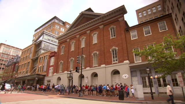 WS View of Fords theatre with people lining up in sidewalk / Washington, District of Columbia, United States