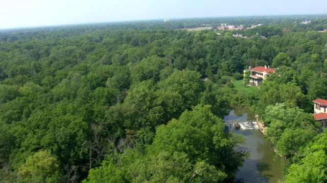 ws aerial pan view of  forest to fair lane estate mansion / dearborn, michigan, united states - dearborn michigan stock videos and b-roll footage