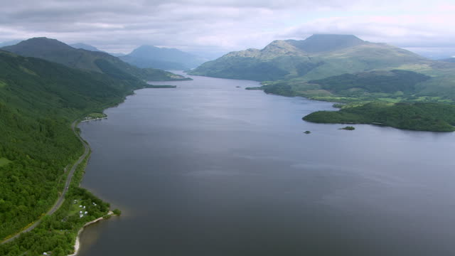 ws aerial view of forested islands in national park with mountain ben lomond / loch lomond, argyll and bute, scotland - ben lomond stock videos and b-roll footage