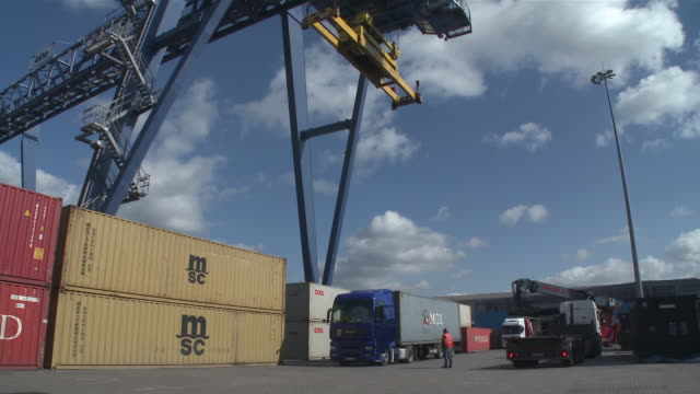ws view of forklift truck, crane and cargo container at harbor / duisburg, north rhine westfalia, germany - container stock videos & royalty-free footage