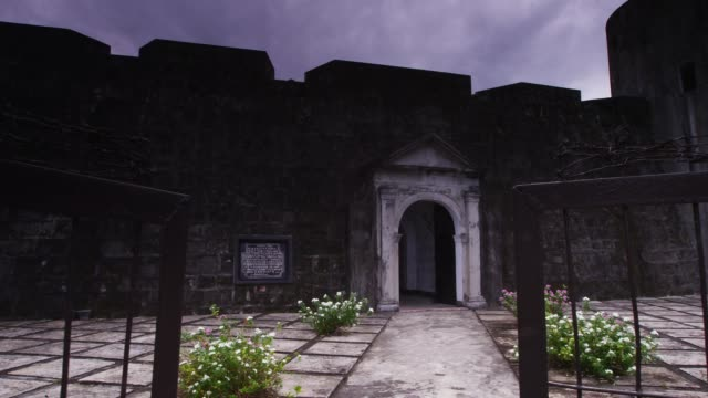 view of fort belgica walls and doors in banda island, maluku, indonesia - 要塞点の映像素材/bロール
