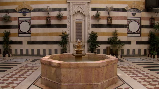 ws view of fountain in courtyard / marrakech - palace video stock e b–roll