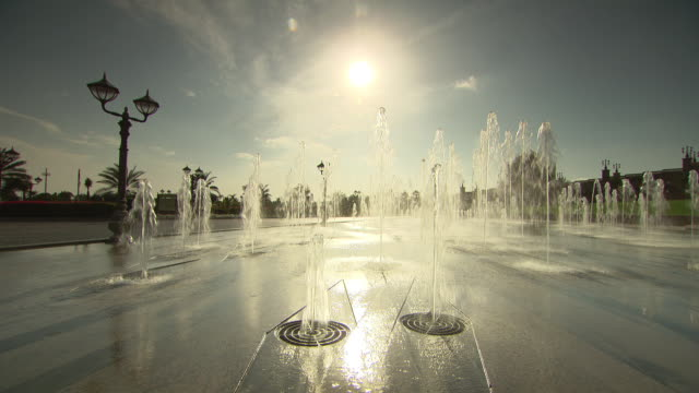 WS View of fountain in front of Emirates Palace / Abu Dhabi, United Arab Emirates