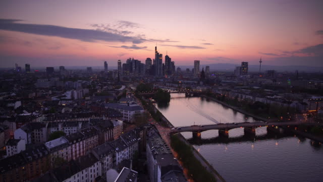 view of frankfurt city skyline in germany at twilight - skyline stock videos & royalty-free footage