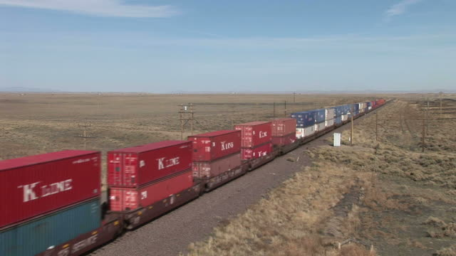 view of freight train passing in wyoming united states - c119gs stock videos & royalty-free footage