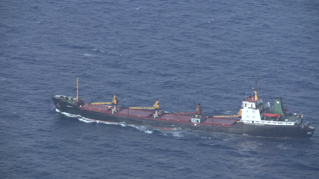 ws aerial ts view of freighter moving ahead on open water / dodecanese, greece - greece stock videos & royalty-free footage