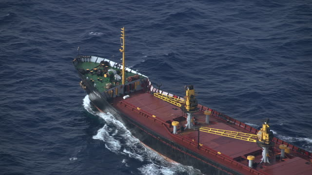 MS AERIAL View of freighter moving ahead on open water / Dodecanese, Greece